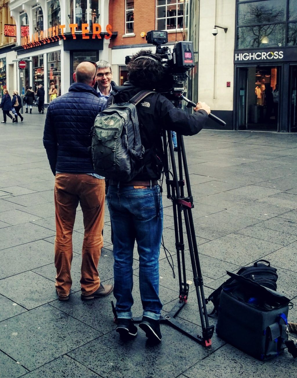 Man being interviewed by TV crew